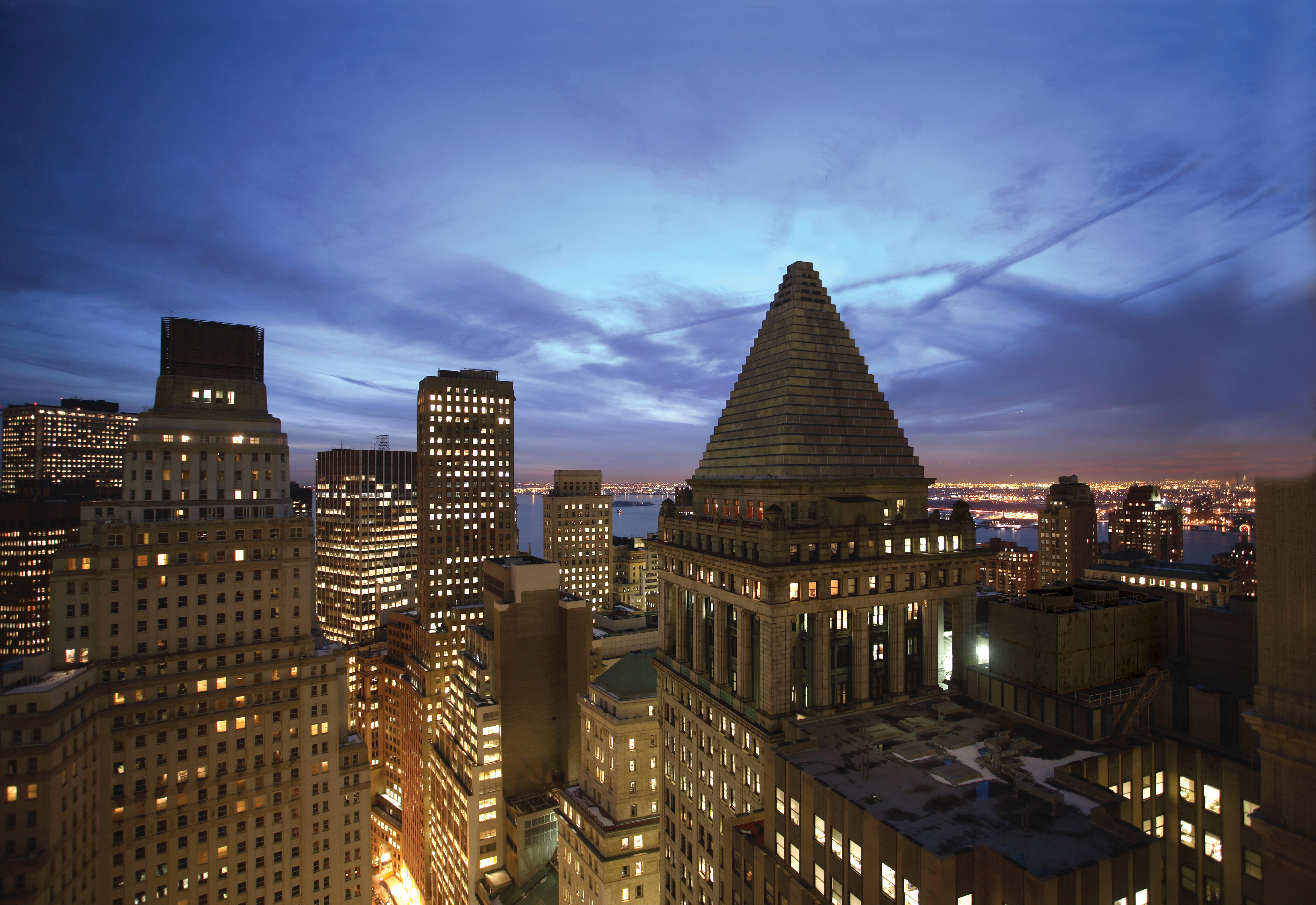 Billionaire investor planning Wall Street office tower spa Real Estate Weekly