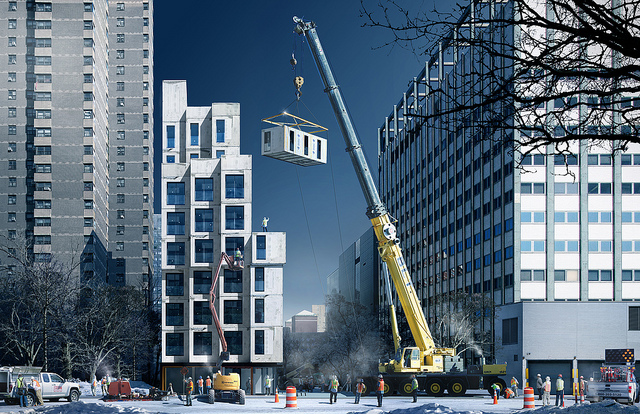 Pre-fabricated units are lifted onto the East 27th Street site.