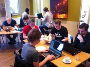 A hot desk environment allows space sharing.