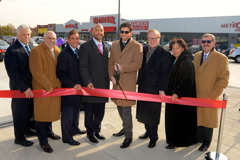 Pictured (L to R): at the ribbon-cutting ceremony marking the official opening of the new Throggs Neck Shopping Center in the Bronx are: Thomas Messina, representative of Congressman Joseph Crowley's office, Assemblyman Michael Benedetto, Senator Jeff Klein, Bronx Borough President Rubin Diaz, Joseph Simone, president of Simone Development Companies, Joseph Kelleher, president Simone Metro Properties, Marlene Cintron, president of BOEDC, and Lenny Caro, president of the Bronx Chamber of Commerce. PHOTO BY JOHN VECCHIOLLA