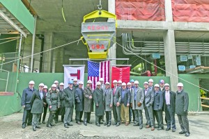 Executives from The Moinian Group, including Joseph Moinian (center, right) and Oskar Brecher (far right), Tishman Construction, including Jay Badame (center, left), and the Building and Construction Trades Council of Greater New York, including Gary LaBarbera (far right, behind) celebrated the topping out of 605 West 42nd Street (inset left) the largest rental residential development currently under construction in Manhattan.