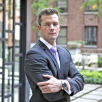 Ryan Serhant, vice president of Nest Seekers International, a brokerage for residential and vacation properties, stands for a photo at the 99 John Deco Lofts condo building in New York, U.S., on Friday, July 30, 2010. In March, the Federal Housing Administration (FHA) agreed to insure mortgages made at the 442-unit conversion project, allowing buyers to acquire an apartment with a down payment of as little as 3.5 percent. The development had 10 units go into contract with FHA backing, but the agency suspended its support for the building on August 3. Photographer: Ramin Talaie/Bloomberg *** Local Caption *** Ryan Serhant
