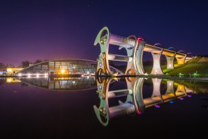 The Falkirk Wheel is a rotating boat lift in Scotland, connecting the Forth and Clyde Canal with the Union Canal.