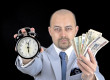 man holding Money and alarm wearing a business suit, race agains