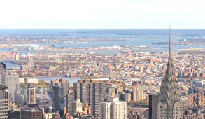 View of the Manhattan cityscape from the Empire State Building in New York, NY.