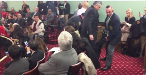 Several protesters were dragged from the council meeting.
