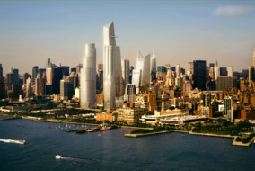 A rendering shows how the completed first phase of the Hudson Yards commercial development will look from across the Hudson River in New York, U.S., in this handout photo released to the media on Aug. 23, 2013. Tilting towers contain commercial space while rounded towers are residential or mixed use. The dark area in front of the tower will host a second phase for an ultimate total of 13 million square feet. Source: The Related Companies via Bloomberg