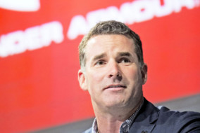 Kevin Plank, chief executive officer of Under Armour Inc., speaks during a news conference in New York, U.S., on Thursday, July 31, 2014. Under Armour Inc., the maker of compression T-shirts and other athletic apparel, launched its most expansive global women's marketing campaign. Photographer: Jin Lee/Bloomberg *** Local Caption *** Kevin Plank