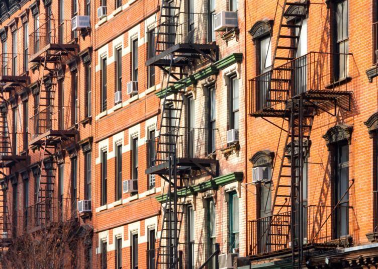 Block of Crowded Apartment Buildings in New York City